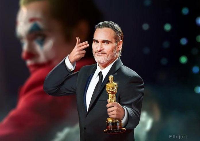 Joaquin Phoenix berposes usai meraih Piala Oscar 2020 sebagai Aktor Pria Terbaik.(asianews)