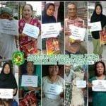 foto dengan tulisan di dada menyatakan orang miskin penerima beras bantuan Pemko Medan.