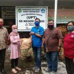 Pengurus DPD KNPI Sumatera Utara lakukan Bakti Sosial berupa pembagian masker di SD Negeri 060809.