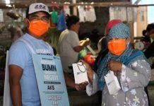 PT Indonesia Asahan Aluminium Persero atau (INALUM) saat memberikan bantuan masker.