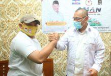 Calon Walikota Medan, Akhyar Nasution dan Kordinator Umum Fraksi Forum Merah Putih, Saputra