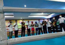 Ketua Umum Komite Olahraga Nasional Indonesia (KONI) Pusat, Marciano Norman membuka secara resmi eksebisi kickboxing Pekan Olahraga Nasional (PON) XX Papua 2020 yang digelar di Aula Asrama Haji Jayapura, Papua, Rabu (22/9/2021) kemarin.